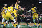 Boston Celtics center Enes Kanter (11) is surrounded by Los Angeles Lakers as he tries to follow his rebound with a shot during the first half of an NBA basketball game in Boston, Monday, Jan. 20, 2020. (AP Photo/Charles Krupa)