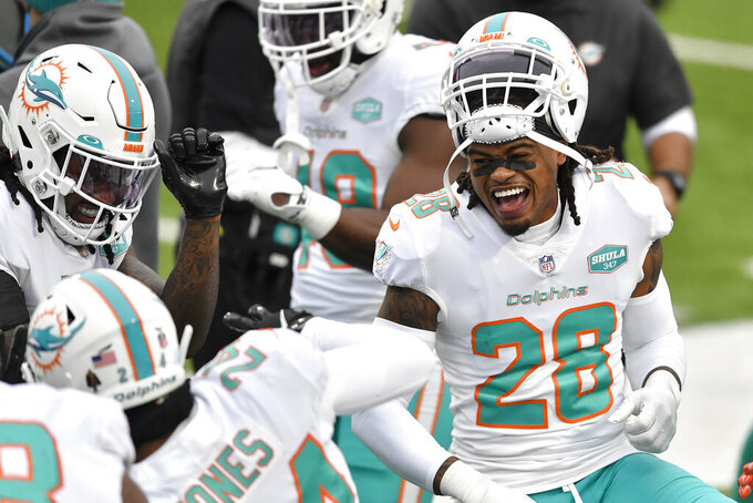 Miami Dolphins strong safety Bobby McCain (28) reacts in the first half of an NFL football game against the Buffalo Bills, Sunday, Jan. 3, 2021, in Orchard Park, N.Y. (AP Photo/Adrian Kraus)