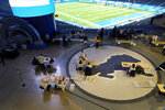 "Poll volunteers work inside Ford Field, Tuesday, Nov. 3, 2020, in Detroit. Michigan Secretary of State Jocelyn Benson said ""I'm grateful for our sports partners in Detroit,"" Benson said Tuesday night at the home of the Detroit Lions. ""They really led the way for sports teams across the country to play a critical role in providing the resources we needed to run the election successfully this year. (AP Photo/Carlos Osorio)"