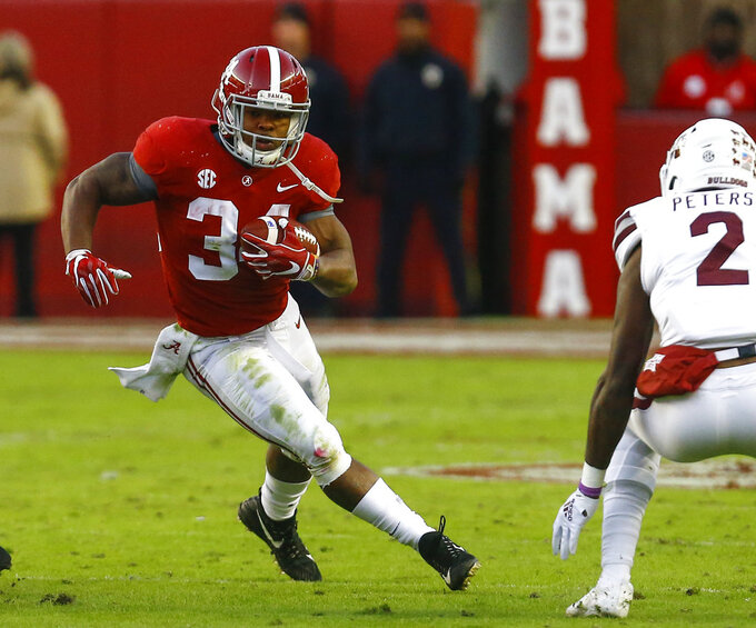 Alabama running back Damien Harris (34) carries the ball during the second half of an NCAA college football game against Mississippi State, Saturday, Nov. 10, 2018, in Tuscaloosa, Ala. (AP Photo/Butch Dill)