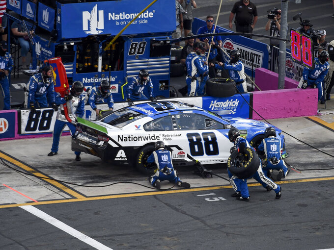 CORRECTS DAY TO SUNDAY Alex Bowman (88) makes a pit stop after damaging his tires on the first lap of a NASCAR Cup Series auto race at Charlotte Motor Speedway Sunday, Sept. 29, 2019 in Concord, N.C. (AP Photo/Mike McCarn)