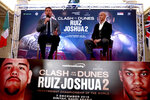 Boxing promoters Eddie Hearn and managing partner of Skill Challenge Entertainment Omar Khalil sit, during a press conference at The Savoy Hotel, London, Monday, Aug. 12, 2019. Anthony Joshua's promoters say his world heavyweight title rematch against Andy Ruiz Jr. will take place in Diriyah, Saudi Arabia, on Dec. 7. (Ian Walton/PA via AP)