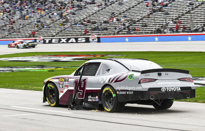 Brandon Jones returns to pit road after getting a jack stuck to his car from a previous pit stop during a NASCAR auto race at Texas Motor Speedway, Saturday, March 30, 2019, in Fort Worth, Texas. (AP Photo/Randy Holt)