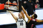 Iowa guard Joe Wieskamp drives to the basket ahead of Northern Illinois guard Trendon Hankerson, right, during the first half of an NCAA college basketball game, Sunday, Dec. 13, 2020, in Iowa City, Iowa. (AP Photo/Charlie Neibergall)