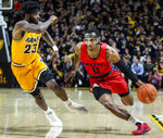 Dayton guard Rodney Chatman (0) drives down court as VCU forward Issac Vann (23) plays defense during the first half of an NCAA college basketball game, Tuesday, Feb. 18, 2020, in Richmond, Va. (AP Photo/Zach Gibson)