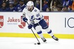 Tampa Bay Lightning's Nikita Kucherov (86) looks to pass the puck during the second period of the team's NHL hockey game against the New York Islanders on Friday, Nov. 1, 2019, in Uniondale, N.Y. (AP Photo/Frank Franklin II)