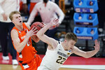 Syracuse's Marek Dolezaj (21) is fouled by West Virginia's Sean McNeil (22) as he goes to the basket during the second half of a second-round game in the NCAA men's college basketball tournament at Bankers Life Fieldhouse, Sunday, March 21, 2021, in Indianapolis. (AP Photo/Darron Cummings)