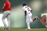 Minnesota Twins' Jorge Polanco (11) rounds the bases on a two-run home run off Los Angeles Angels pitcher Tyler Skaggs in the first inning of a baseball game Monday, May 13, 2019, in Minneapolis. (AP Photo/Jim Mone)