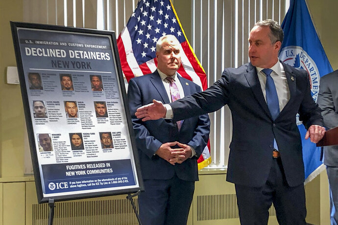 Matthew Albence, right, the acting director of U.S. Immigration and Customs Enforcement, speaks during a news conference, Friday, Jan. 17, 2020, in New York. The country's top immigration official blamed the