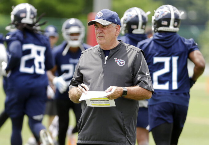 FILE- In this May 30, 2018, file photo, Tennessee Titans defensive coordinator Dean Pees watches duringNFL football training facility in Nashville, Tenn. Arthur Smith, the new Atlanta Falcons coach, has started building his staff by hiring offensive coordinator Dave Ragone, defensive coordinator Dean Pees and special teams coach Marquice Williams. (AP Photo/Mark Humphrey, File)