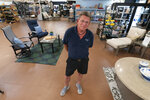 In this July 6, 2021, photo John Hessler, 62, the patio section manager at Valley View Farms in Cockeysville, Md., poses for The Associated Press in his showroom. (AP Photo/Julio Cortez)