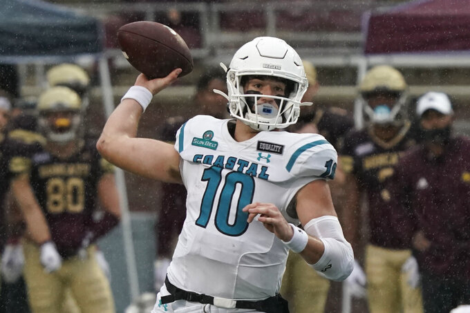 Coastal Carolina's Grayson McCall (10) throws during the first half of an NCAA college football game against Texas State in San Marcos, Texas, Saturday, Nov. 28, 2020. (AP Photo/Chuck Burton)