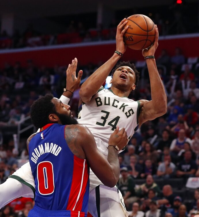Milwaukee Bucks forward Giannis Antetokounmpo (34) is fouled by Detroit Pistons center Andre Drummond (0) during the first half of Game 4 of a first-round NBA basketball playoff series, Monday, April 22, 2019, in Detroit. (AP Photo/Carlos Osorio)