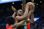 Toronto Raptors' OG Anunoby, left, and Chris Boucher, behind, double-team Boston Celtics' Kemba Walker (8) during the first half on an NBA basketball game in Boston, Saturday, Dec. 28, 2019. (AP Photo/Michael Dwyer)