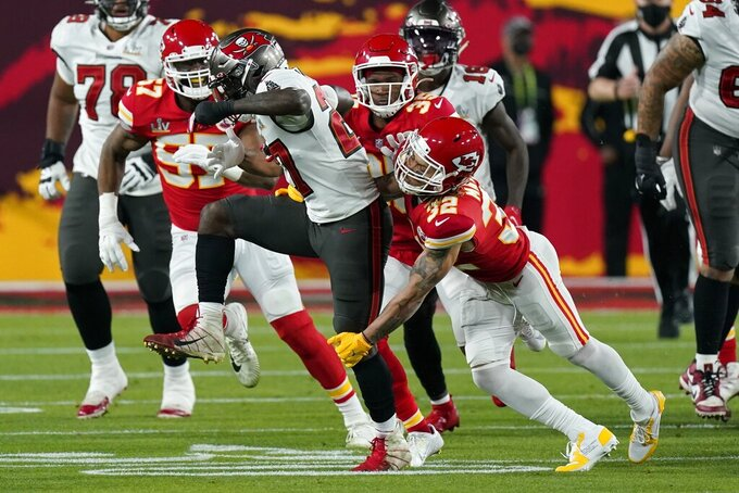 Kansas City Chiefs strong safety Tyrann Mathieu tackles Tampa Bay Buccaneers running back Ronald Jones during the first half of the NFL Super Bowl 55 football game Sunday, Feb. 7, 2021, in Tampa, Fla. (AP Photo/Mark Humphrey)