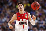 FILE - In this Nov. 17, 2019, file photo, LaMelo Ball of the Illawarra Hawks brings the ball up during a game against the Sydney Kings in the Australian Basketball League in Sydney. The Charlotte Hornets selected Ball in the NBA draft Wednesday, Nov. 18. (AP Photo/Rick Rycroft, File)
