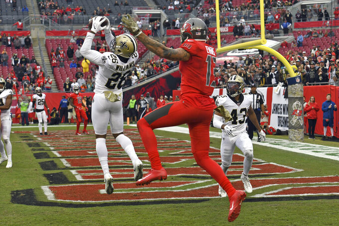 Evans held in check as Saints beat Bucs 34-17