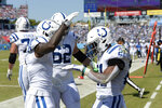Indianapolis Colts running back Nyheim Hines (21) celebrates with Parris Campbell (1) after Hines scored a touchdown against the Tennessee Titans in the first half of an NFL football game Sunday, Sept. 26, 2021, in Nashville, Tenn. (AP Photo/Mark Zaleski)