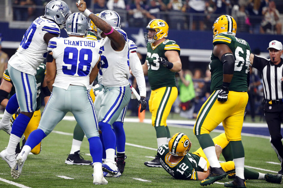 Justin McCray, Aaron Rodgers, Tyrone Crawford, David Irving, DeMarcus Lawrence