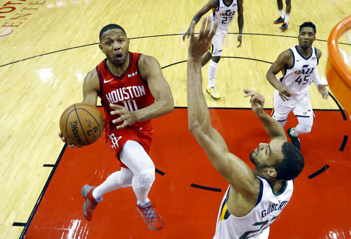 In this April 24, 2018, fphoto, Houston Rockets guard Eric Gordon (10) drives to the basket past Utah Jazz center Rudy Gobert (27) during the second half of Game 5 of a first-round NBA basketball playoff series in Houston. A person with knowledge of the situation tells The Associated Press that the Houston Rockets and Gordon have agreed on a contract extension. It's for at least three years, starting in 2020-21, with an option that a fourth season could be added. (AP Photo/David J. Phillip, File)