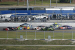 Kyle Larson (42) and Jimmie Johnson (48) begin a multi-car accident on the final lap of the NASCAR Clash auto race as Austin Dillon (3), Kyle Busch (18), Kasey Kahne (95), Chase Elliott (9) and Denny Hamlin (11) try to avoid them at Daytona International Speedway Sunday, Feb. 11, 2018, in Daytona Beach, Fla. (AP Photo/Phelan M. Ebenhack)