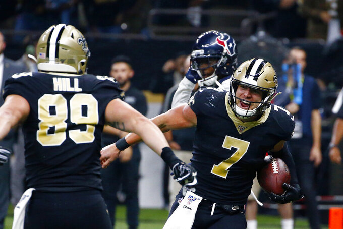 New Orleans Saints quarterback Taysom Hill (7) celebrates his touchdown reception with tight end Josh Hill (89) in the second half of an NFL football game against the Houston Texans in New Orleans, Monday, Sept. 9, 2019. (AP Photo/Butch Dill)