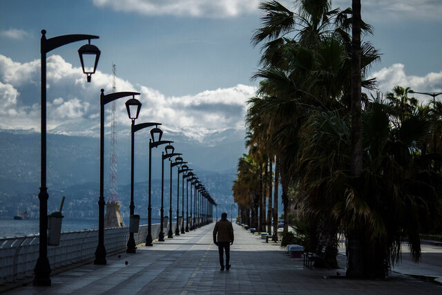 A man walks at Beirut's seaside corniche, or waterfront promenade, along the Mediterranean Sea, which is almost empty of residents and tourists in Beirut, Lebanon, Saturday, March 21, 2020. For most people, the new coronavirus causes only mild or moderate symptoms, such as fever and cough. For some, especially older adults and people with existing health problems, it can cause more severe illness, including pneumonia. (AP Photo/Hassan Ammar)
