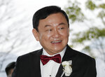 Former Thai Prime Minister Thaksin Shinawatra welcomes his guests for the wedding of his youngest daughter Paetongtarn