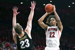 Arizona forward Zeke Nnaji (22) shoots over Colorado forward Lucas Siewert during the second half of an NCAA college basketball game Saturday, Jan. 18, 2020, in Tucson, Ariz. Arizona won 75-54. (AP Photo/Rick Scuteri)