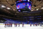 The New York Rangers celebrate a win over the New York Islanders in an NHL hockey game Saturday, Jan. 16, 2021, in New York. (Bruce Bennett/Pool Photo via AP)