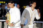 FILE - In this Sunday, July 6, 2008, file photo, Spain's Rafael Nadal left, walks with his trophy past Switzerland's Roger Federer after winning the men's singles final on the Centre Court at Wimbledon. (AP Photo/Anja Niedringhaus, File)