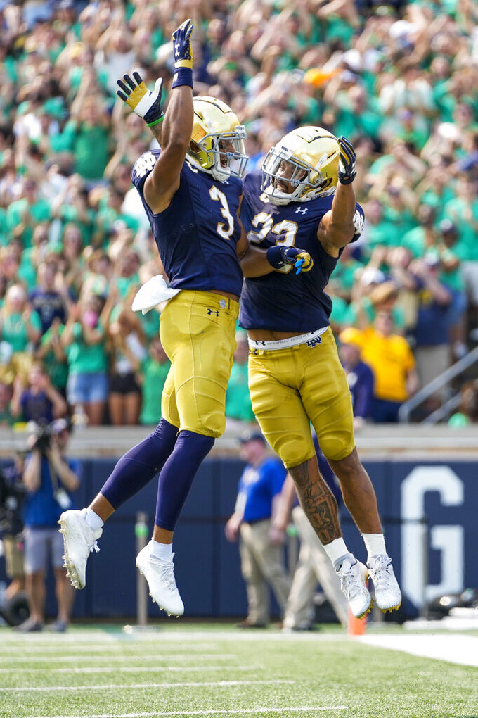 Notre Dame running back Kyren Williams (23) celebrates a touchdown with teammate Avery Davis (3) during an NCAA college football game against Toledo in South Bend, Ind., Saturday, Sept. 11, 2021. (AP Photo/AJ Mast)