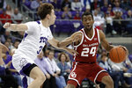 TCU guard Francisco Farabello (3) defends as Oklahoma guard Jamal Bieniemy (24) looks for an opening to the basket in the first half of an NCAA college basketball game in Fort Worth, Texas, Saturday, March 7, 2020. (AP Photo/Tony Gutierrez)