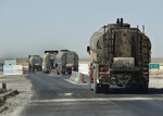 FILE - In this April 4, 2018 file photo, a convoy of oil trucks passing a Kurdish police (Assayesh) checkpoint, as they moving fuel produced in Kurdish-held areas in the east to other areas controlled by the same U.S-backed group to the west, on a highway in Hassakeh province, Syria. Syrians living in government-controlled areas have survived eight years of war now face a new scourge in the form of widespread fuel shortages. (AP Photo/Hussein Malla, File)
