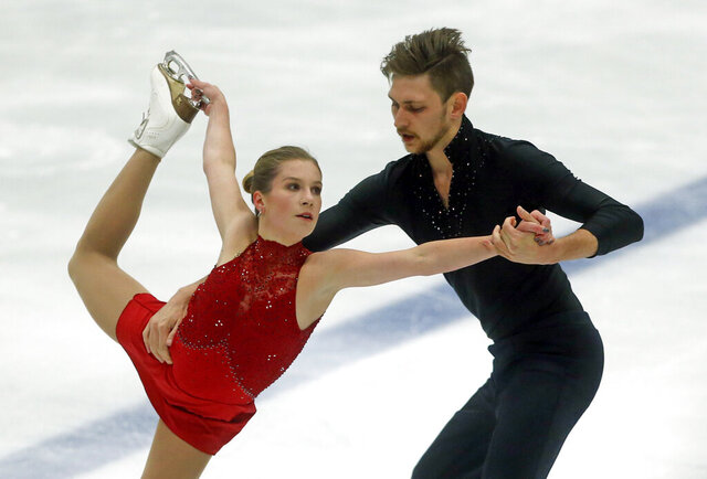 FILE - In this Friday, Sept. 14, 2018 file photo, Ekaterina Alexandrovskaya and Harley Windsor, of Australia, perform during the pairs free skate at the U.S. International Figure Skating Classic, in Salt Lake City. Former world junior pairs figure skating champion Ekaterina Alexandrovskaya has died in Moscow, the Russian state news agency Tass reported Saturday, July 18, 2020 citing unnamed sources. Moscow police have yet to respond to a request for comment from The Associated Press. (AP Photo/Rick Bowmer, file)