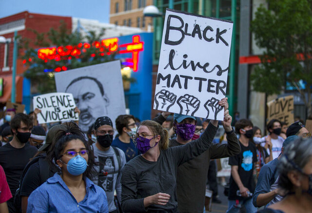 Demonstrators protest the death of George Floyd in downtown Albuquerque, N.M., Sunday, May 31, 2020. Floyd was a black man who died in police custody in Minneapolis on May 25. (AP Photo/Andres Leighton)