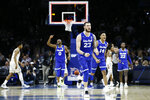 Seton Hall's Sandro Mamukelashvili (23), Quincy McKnight (0), Jared Rhoden (14) and Myles Cale (22) celebrate after an NCAA college basketball game against Villanova, Saturday, Feb. 8, 2020, in Philadelphia. (AP Photo/Matt Slocum)