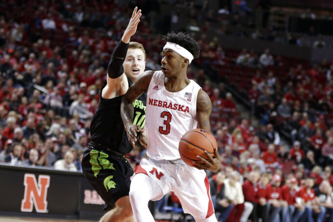 Michigan State's Jack Hoiberg (10) defends against Nebraska's Cam Mack (3) during the first half of an NCAA college basketball game in Lincoln, Neb., Thursday, Feb. 20, 2020. (AP Photo/Nati Harnik)