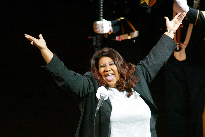 FILE - In this June 15, 2004 file photo, singer Aretha Franklin sings the national anthem before the start of game 5 of the NBA Finals between the Detroit Pistons and the Los Angeles Lakers in Auburn Hills, Mich. Michigan Gov. Gretchen Whitmer signed legislation Monday, July, 8, 2019, honoring the late Queen of Soul with a highway designation. (AP Photo/Al Goldis, File)