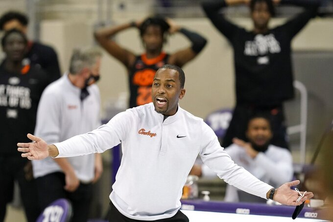 Oklahoma State coach Mike Boynton gestures to officials during the second half of the team's NCAA college basketball game against TCU in Fort Worth, Texas, Wednesday, Feb. 3, 2021. (AP Photo/Tony Gutierrez)