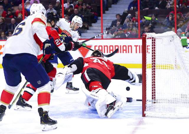 Florida Panthers right wing Evgenii Dadonov (63) blasts the puck past Ottawa Senators goaltender Craig Anderson (41) during the first period of an NHL hockey game, Thursday, Jan. 2, 2020 in Ottawa, Ontario. (Sean Kilpatrick/The Canadian Press via AP)