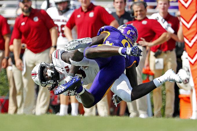 South Carolina's Dakereon Joyner (5) is taken down by East Carolina's D.J. Ford (9) during the second half of an NCAA college football game in Greenville, N.C., Saturday, Sept. 11, 2021. (AP Photo/Karl B DeBlaker)