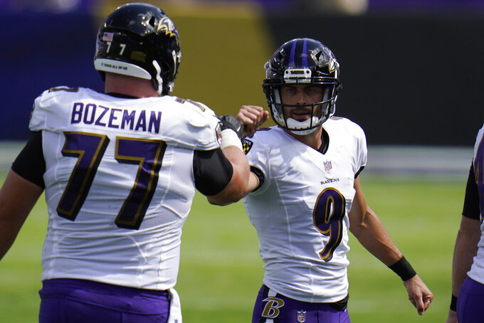Baltimore Ravens offensive guard Bradley Bozeman (77) congratulates kicker Justin Tucker (9), after Tucker kicked a field goal, during the first half of an NFL football game against the Cleveland Browns, Sunday, Sept. 13, 2020, in Baltimore, MD. (AP Photo/Julio Cortez)