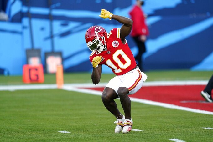 Kansas City Chiefs wide receiver Tyreek Hill warms up before the NFL Super Bowl 55 football game between the Kansas City Chiefs and Tampa Bay Buccaneers, Sunday, Feb. 7, 2021, in Tampa, Fla. (AP Photo/Ashley Landis)