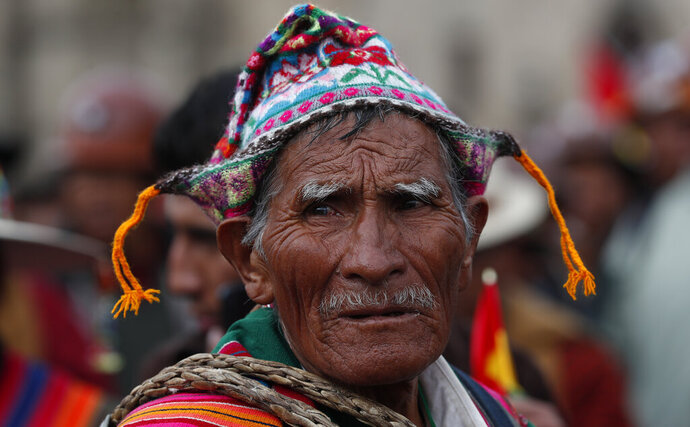 A Quechua indigenous supporter of Bolivian President Evo Morales attends a march in defense of his apparent reelection in La Paz, Bolivia, Tuesday, Nov. 5, 2019. Backers of Bolivia's president blocked the arrival of an opposition leader Luis Fernando Camacho to the capital of La Paz on Tuesday and the government flew him back to his home city amid protests over Morales' apparent reelection. (AP Photo/Juan Karita)