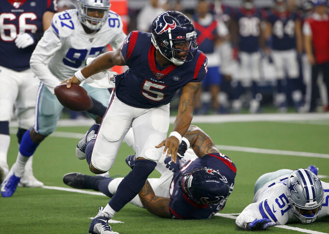 Houston Texans' Joe Webb (5) scrambles out of the pocket in the first half of a preseason NFL football game against the Dallas Cowboys in Arlington, Texas, Saturday, Aug. 24, 2019. (AP Photo/Ron Jenkins)