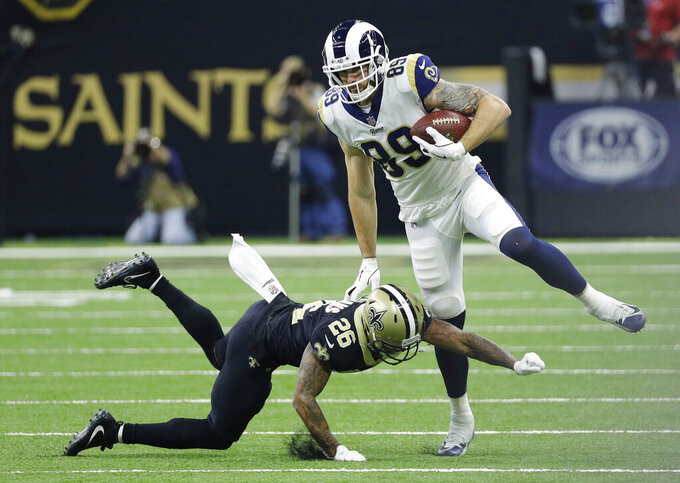 Los Angeles Rams' Tyler Higbee tries to get past New Orleans Saints' P.J. Williams during the first half of the NFL football NFC championship game, Sunday, Jan. 20, 2019, in New Orleans. (AP Photo/David J. Phillip)