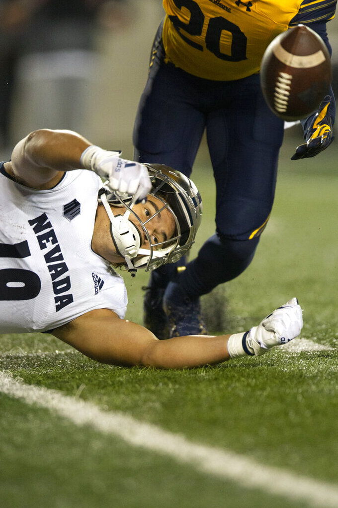 Nevada tight end Cole Turner (19) can't hold onto a pass in front of California cornerback Josh Drayden (20) during the fourth quarter of an NCAA college football game, Saturday, Sept. 4, 2021, in Berkeley, Calif. (AP Photo/D. Ross Cameron)