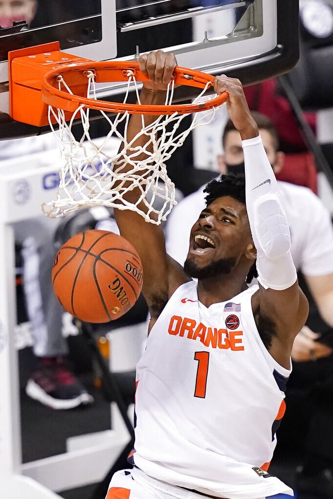 Syracuse forward Quincy Guerrier (1) dunks during the first half of an NCAA college basketball game against North Carolina State in the second round of the Atlantic Coast Conference tournament in Greensboro, N.C., Wednesday, March 10, 2021. (AP Photo/Gerry Broome)