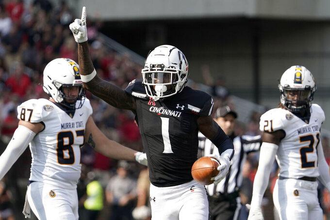 Cincinnati cornerback Ahmad Gardner (1) reacts after intercepting a ball thrown by Murray State quarterback Preston Rice during the first half of an NCAA college football game Saturday, Sept. 11, 2021, in Cincinnati. (AP Photo/Jeff Dean)
